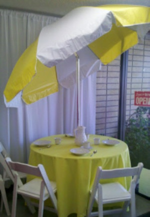 Round Table with Yellow & White Vinyl Umbrella